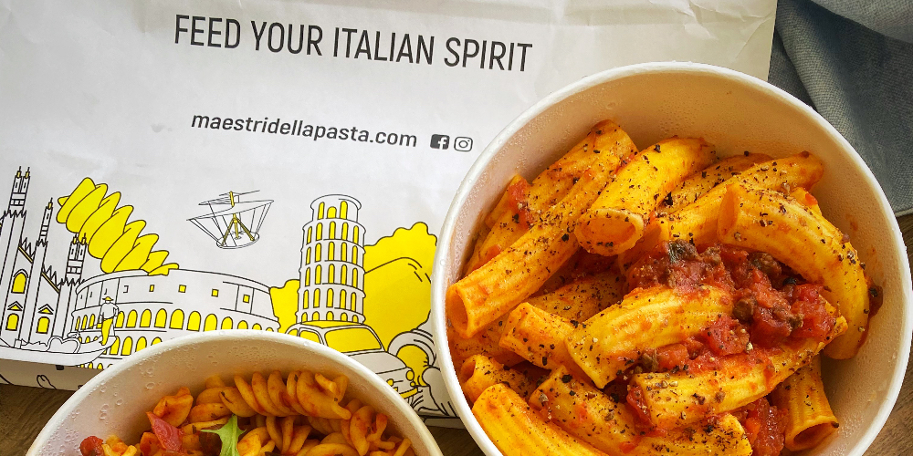 bowls of pasta with a bag in the background saying 'feed your italian spirit'