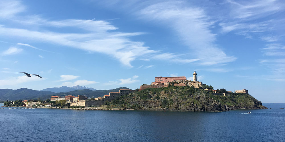 Approaching Elba on the ferry, the castle at Portoferraio welcomes us