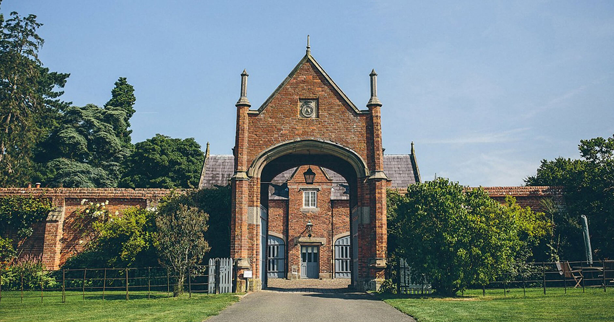 Red brick archway and gatehouse at Combermere Abbey