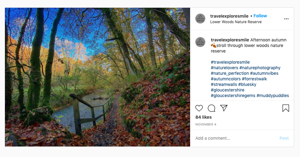 Instagram screenshot from @travelexploresmile showing a path and river through autumn trees