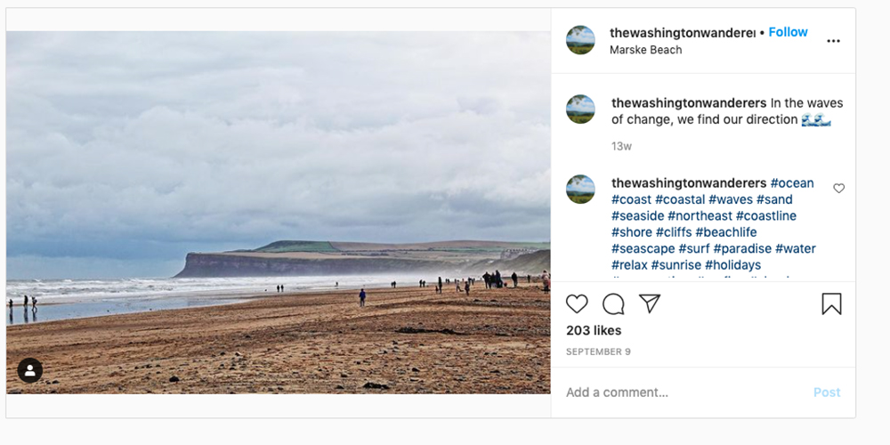 Screenshot from Instagram @thewashingtonwanderers showing Marske Sands beach with headland in the distance, one of the best beaches in England
