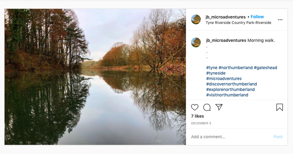 Instagram screenshot showing a still river lined with autumn trees, @jb_microadventures