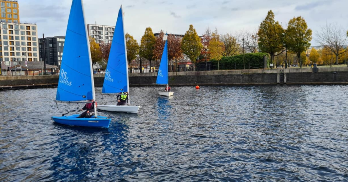 Sailing dinghies on the water at Salford Quays