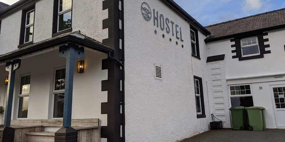 The Rocks Hostel at Plas Curig Front with Logo