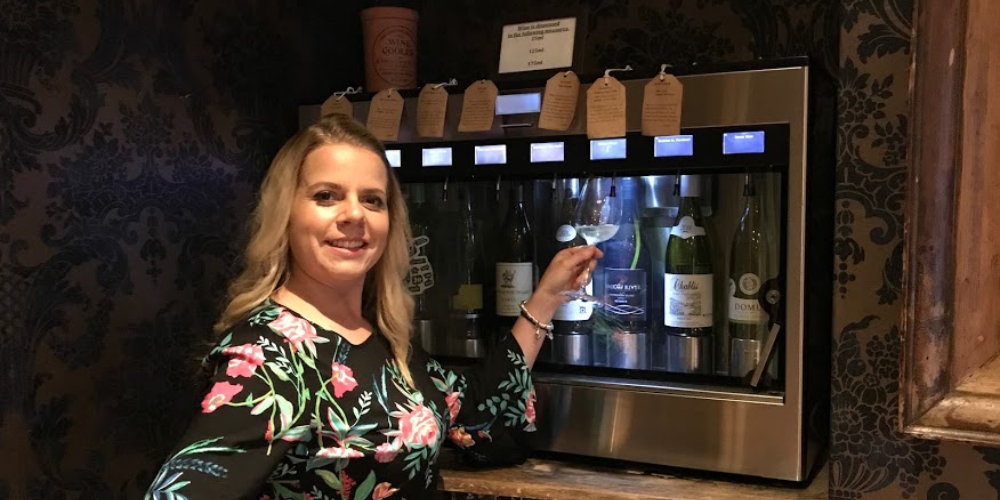 Sarah pouring wine at The Black Bottle in Winchester